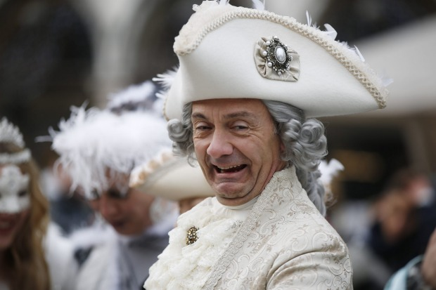 A man impersonating Giacomo Casanova smiles in St. Marks' Square, during the Carnival, in Venice, Italy.