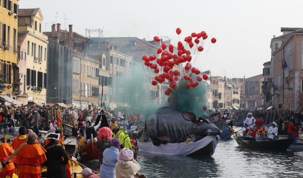 Boats sail along Rio Cannnaregio during the water parade, part of the Venice Carnival, in Venice, Italy. The Venice ...