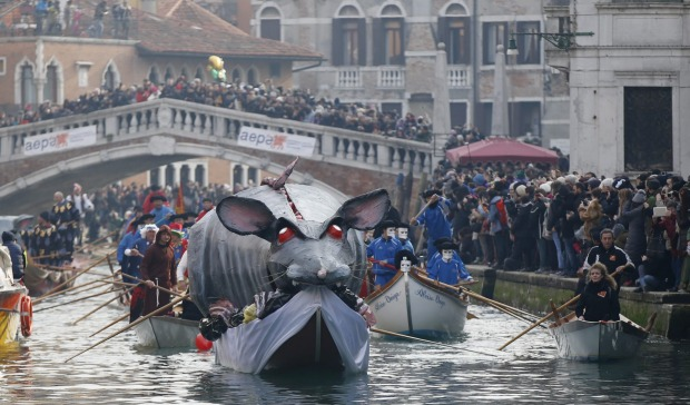 Boats sail during the water parade, part of the Venice Carnival, in Venice, Italy. The Venice carnival in the historical ...