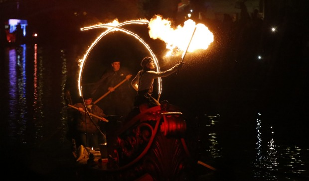 Artists perform with fire at Rio Canneregio for the Carnival Grand Opening show, in Venice, Italy. The Venice carnival ...