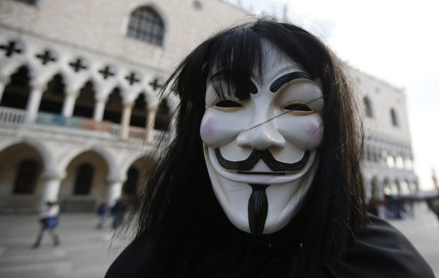 A man wearing an Anonymous mask is seen prior to the Carnival Grand Opening show, in Venice, Italy.