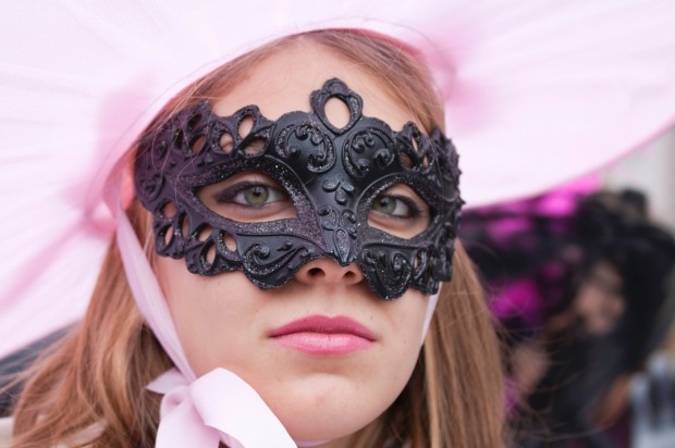 A masked woman in Venice, Italy. The Venice carnival in the historical lagoon city attracts people from around the world.