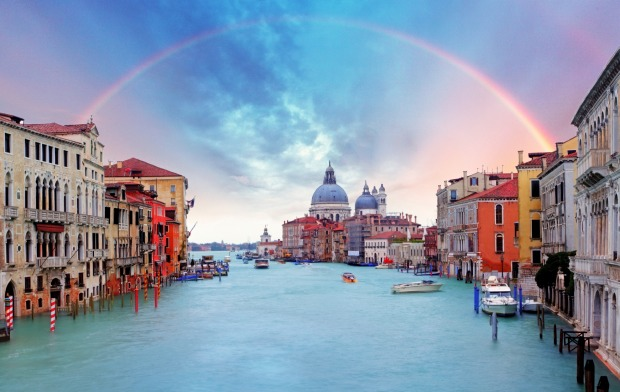 A rainbow shines over the Grand Canal, Venice.