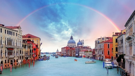 A rainbow forms over the Grand Canal in Venice.