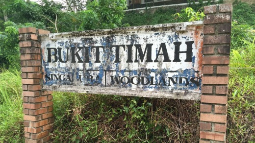 Painted letters peel from a sign. Bukit Timah Railway Station was once an intermediate stop.