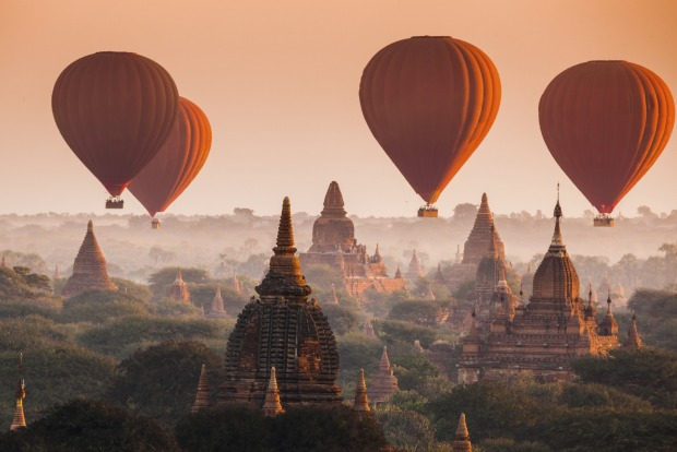 Bagan, Myanmar: More than 2200 temples and pagodas dot the countryside of Bagan and the best way to see them is from the air.