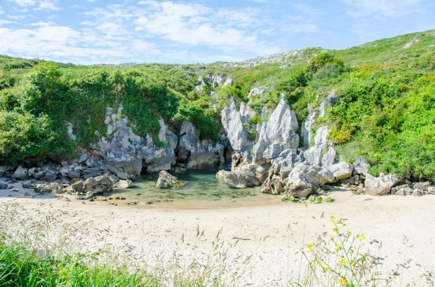 Gulpiyuri Beach, Spain: What is a sandy beach doing in the middle of a meadow, 100 metres from the sea? Gulpiyuri ...