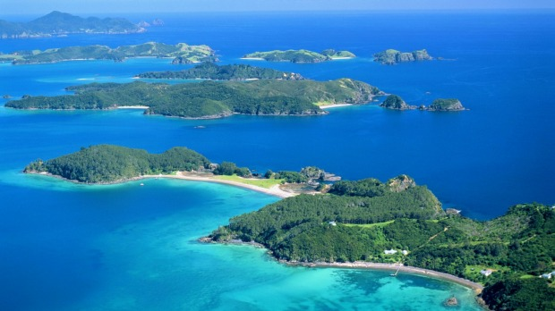 The warm, azure waters and sandy beaches of the Bay of Islands beckon.