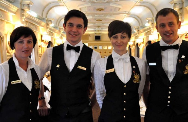 Service staff on the Golden Eagle luxury train.