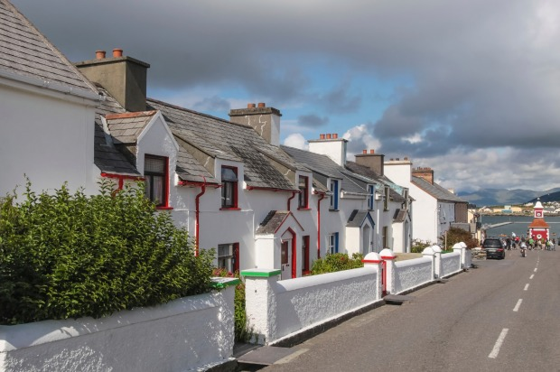 Historic row of houses on Valentia Island at the Ring of Kerry in Cahersiveen, County Kerry, Ireland.