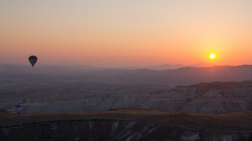 Watching the sunrise from a hot air balloon in  Cappadocia.