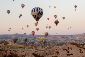 The skies above Cappadocia are filled with hot air balloons.
