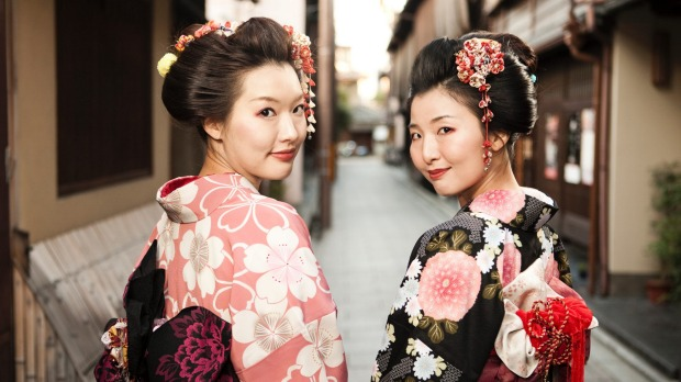 See traditionally dressed geisha's in the the Higashiyama district of Kyoto.