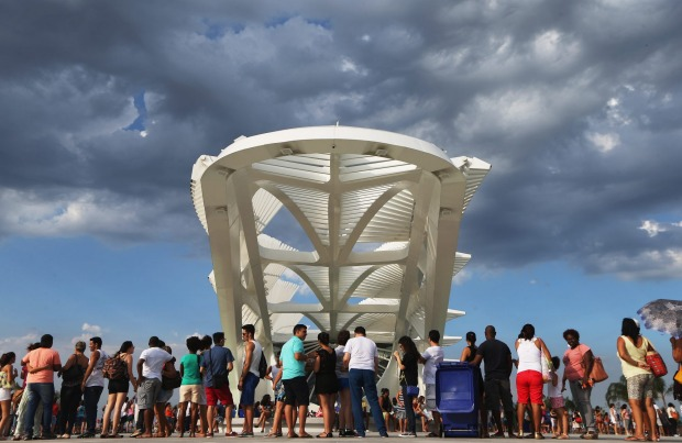 People gather at the opening day of the Museum of Tomorrow, designed by Spanich architect Santiago Calatrava, in the ...
