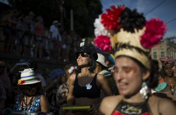 """A reveller performs at the """"Ceu na Terra"""", or Heaven on earth, block party during Carnival celebrations in Rio de ..."""