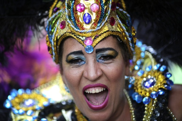 A patient from the Nise de Silveira mental health institute dances in costume during the institute's carnival parade, ...