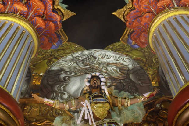 A performer from Uniao da Ilha samba school parades on a float during the Carnival celebrations at the Sambadrome in Rio ...