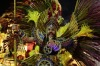 A performer from Estacio de Sa samba school points directly at the camera as he parades on a float during the Carnival ...