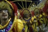 A performer from Estacio de Sa samba school sings as he parades during the Carnival celebrations at the Sambadrome in ...