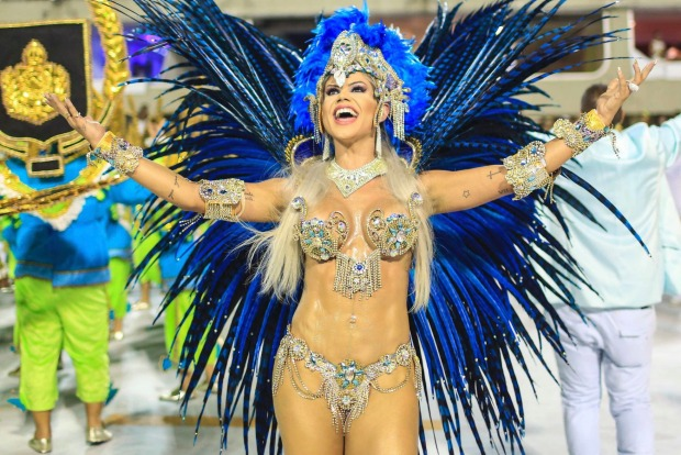 Members of the Academic Rocinha samba school perform during the first day of parades serial access group at Marques de ...