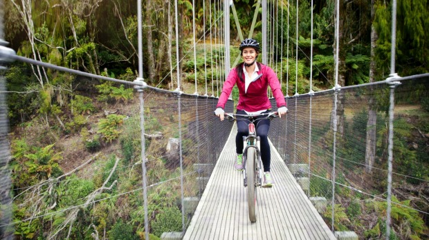Megan Gale crossing the impressive Maramataha Suspension Bridge on The Timber Trail. Some of New Zealand's highest and ...