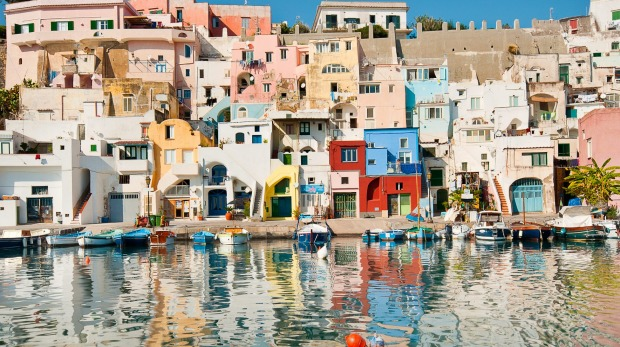The colourful waterfront of Procida island, Italy. The island stood in for the fictional resort town of Mongibello in ...