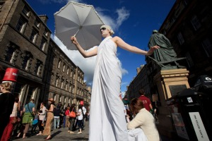 Fringe performers promote their shows on Edinburgh's Royal Mile.