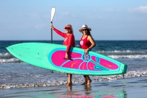 Twin sisters Isabelle and Caroline Tihanyi, founders of Surf Diva – a surfing and stand-up paddle school for women.