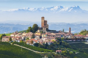 Serralunga d'Alba, a hill town in the Langhe, Piedmont, Italy, with the Alps behind.