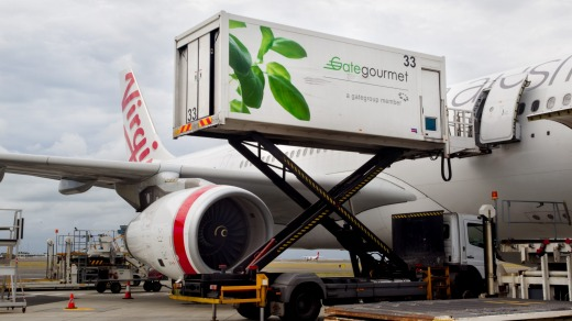 Gate Gourmet Food Production trucks delivering food to Virgin Airlines.