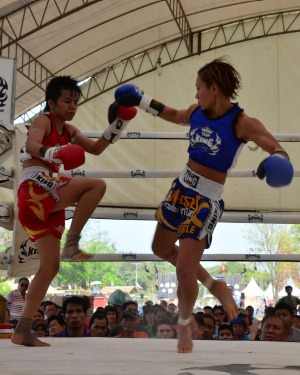 Women compete at Muay Thai, a highly combative form of kickboxing.