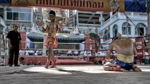 Muay Thai kick boxers performing pre-fight ritual of respect, guidance and safe keeping.