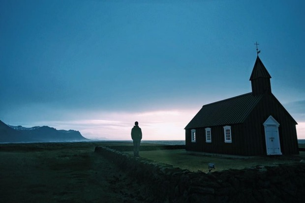 Me standing by aremote Icelandic Lutheran church on the coast.