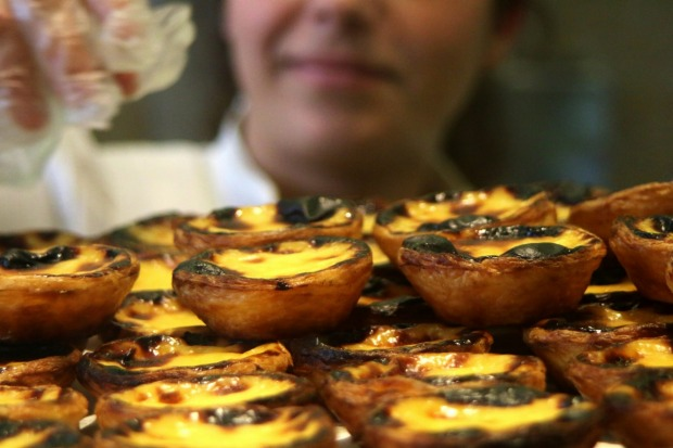 Custard tarts are a famous Portuguese delicacy, and Manteigaria is a bakery in the Chiado district of Lisbon which bakes ...
