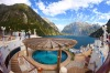 This is where the lifestyle of a cruise. Ship meet the magic of nature at Milford Sound, New Zealand. This phot captures ...