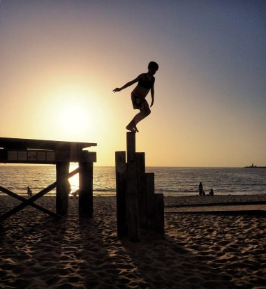 Sunset approaches in Fremantle WA and the young boys were entertaining themselves jumping from the old wharf.