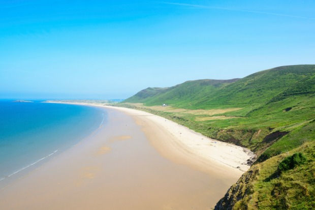 Rhossili Bay Beach, Gower Peninsula, Wales. A beautiful expanse of pristine sand often voted one of the world's best beaches.