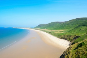 Rhossili Bay Beach, Gower Peninsula, Wales. A beautiful expanse of pristine sand often voted one of the world's best ...