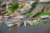 B011R9 Peru, Amazon, Amazon River, Iquitos. Aerial view of the port, harbour and settlements of Iquitos, the principle ...