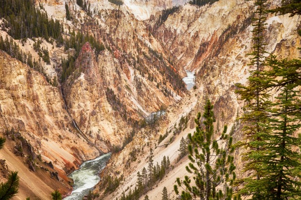 The Grand Canyon in Yellowstone National Park is a deep canyon carved out of the rocks by the Yellowstone River.