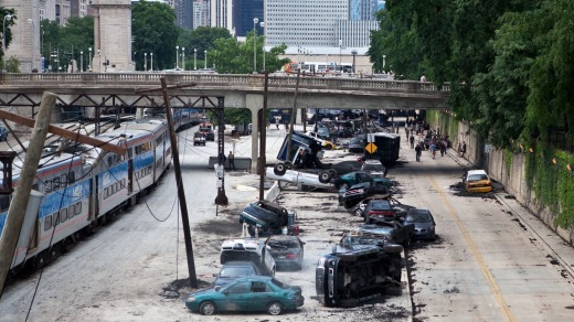 Wrecked cars seen next to a railway track on the set for <i>Transformers, Dark Side of the Moon</i>.