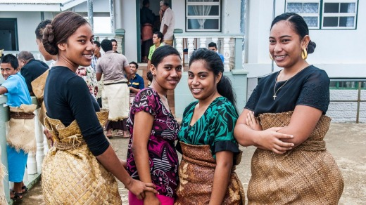 Traditional dressed Tongan women at a church service.