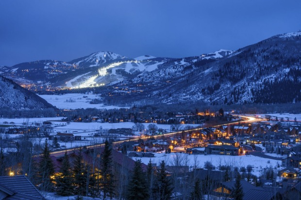 Homes and town glowing at dusk with blue light in Park City, Utah.