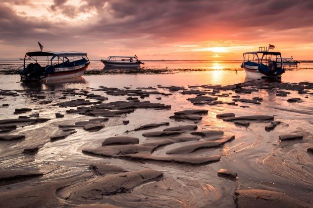 'Southern Sun' The sun rises over Nusa Dua Beach in Bali, Indonesia, painting the low-tide landscape in a purple hue for ...