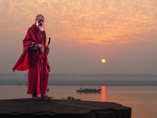 Sunrise over the Ganges in Varanasi, India. I had been watching this man mediate since dawn - as he stood up to leave I ...