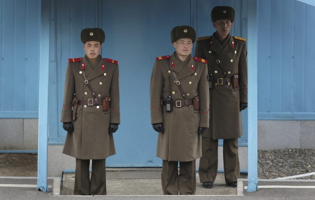 North Korean soldiers guard the truce village of Panmunjom at the Demilitarized Zone (DMZ) which separates the two ...