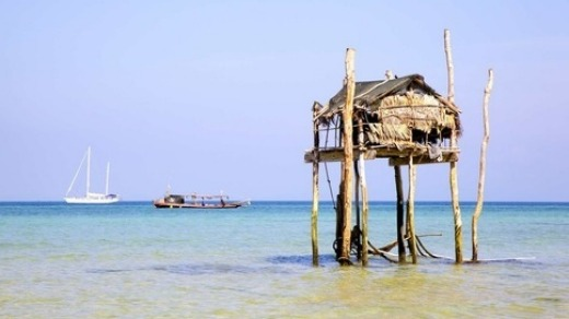Moken hut and tour boat, Mergui Islands, Myanmar.