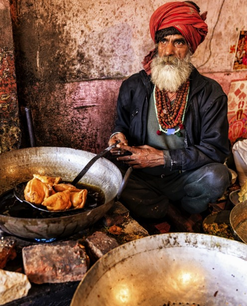 Indian street vendor preparing food in Jaipur, India.