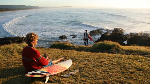 Surfers take to the empty perfect beaches along the Coffs Coast.