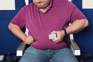 Should there be extra costs for passengers weighing over a specified limit?